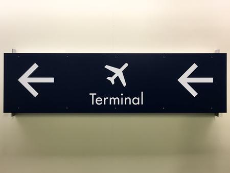 Airport Terminal Arrow Sign on a Wall Reklamní fotografie
