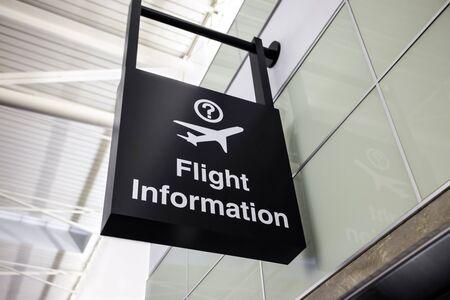 Airport flight information sign hanging on an interior wall Reklamní fotografie