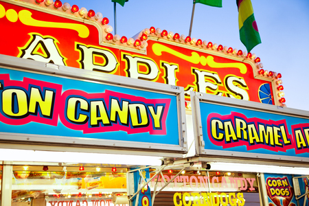 Carnival Concession Stand Signs - A carnival concession stand with caramel apples and cotton candy signs