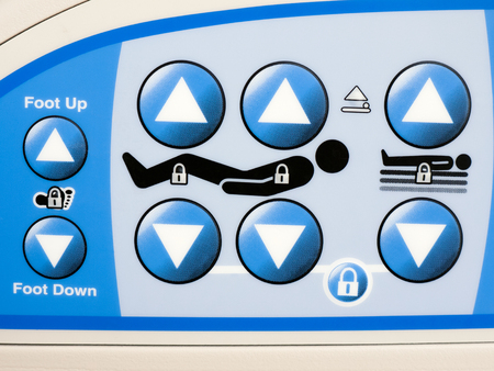 Picture of hospital bed control panel for making bed adjustments to bed height and incline