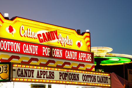 County Fair Food Sign - Picture of county fair food concession stand sign with lemonade, cotton candy, popcorn, and candy apples.