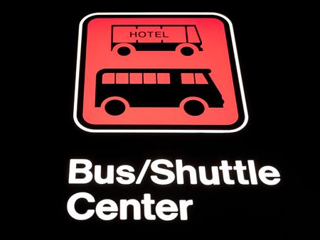 A hotel bus shuttle sign at an airport Reklamní fotografie