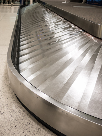 Airport baggage claim carousel conveyer with no luggage Reklamní fotografie