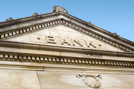 Bank sign on a old stone bank building exterior Reklamní fotografie