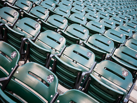 Green sports baseball stadium seats at U.S. Cellular Field, formerly Comiskey Park, in Chicago Illinois USA.