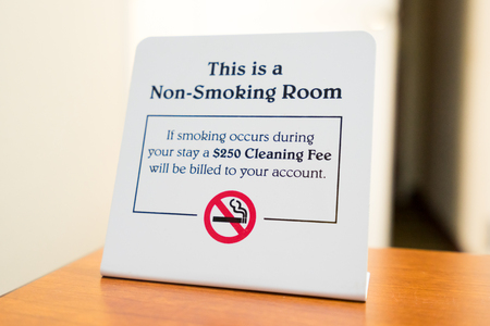 Non-Smoking Sign in a Hotel Room with a $250 cleaning fee.