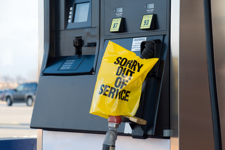 Picture of gas pump with a Sorry Out of Service sign and lock