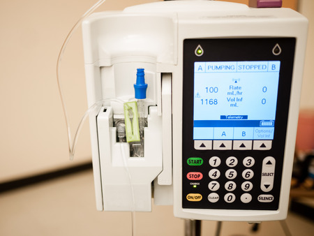 Photo of IV drip intravenous infusion pump medical equipment in a hospital room Reklamní fotografie