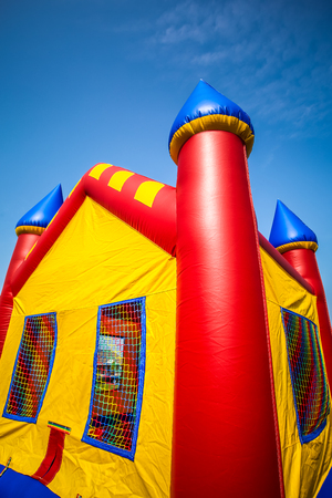 Children's inflatable bouncy castle in red, yellow and blue