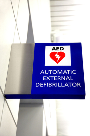 Picture of an Automated External Defibrillator AED sign at an airport