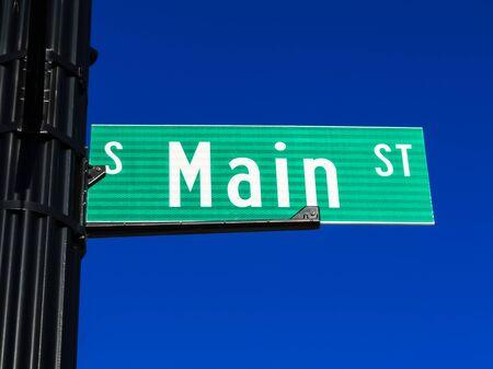 Main Street sign on a street pole.