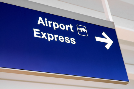 buss: Airport Express overhead directional sign with an arrow