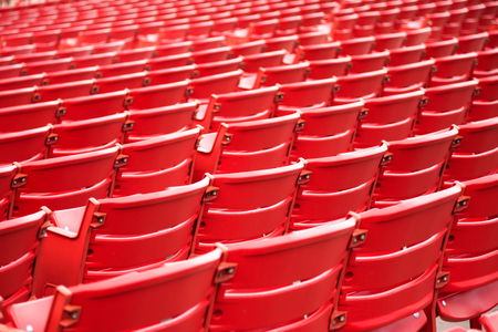 Red stadium seats in a row at a concert venue Stock Photo