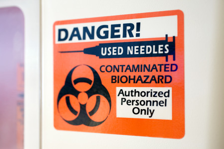Hospital sharps container sign for storing used needles
