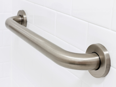 Picture of grab bar handrail in a hotel handicapped disabled access bathroom