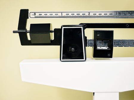 Physician Beam Scale - Medical professional sliding balance weight scale at a physician's office Stock Photo