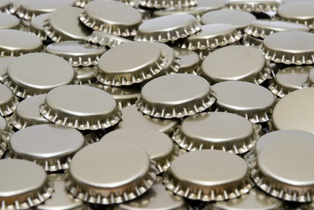 Beer bottle caps in a pile picture