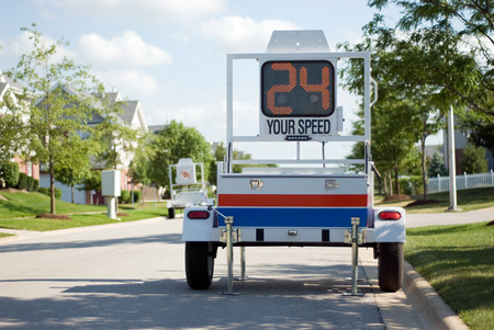 Police Mobile Radar Speed Trailer. Picture of a mobile police radar trailer with an LED sign displaying speed. Stock Photo