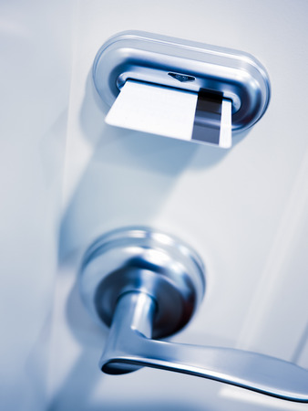 Key card electronic door lock security on a hotel room door. Stock Photo