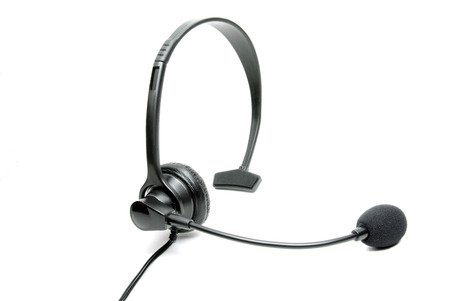 earpiece: Stock photo of a black business telephone headset isolated on a white background.