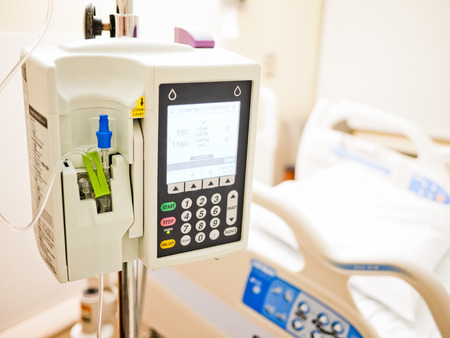 Infusion Pump. Intravenous IV drip medical equipment in a hospital room Reklamní fotografie - 77879070