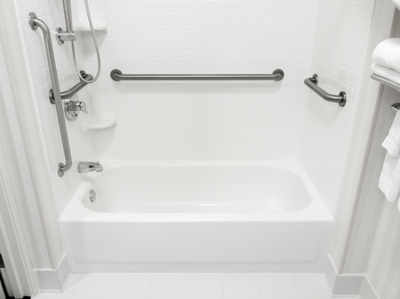 Handicapped disabled access bathroom bathtub with grab bars