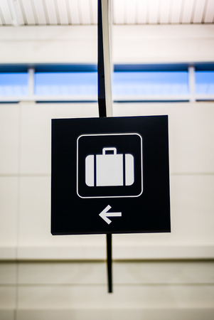 Airport baggage sign with an arrow pointing to the baggage claim Reklamní fotografie