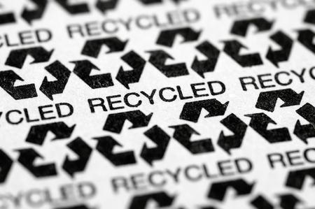 リサイクル ・ リサイクル紙の記号ラベルのマクロ パターンのストック画像 写真素材