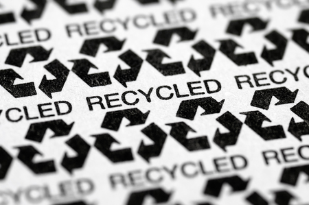 Stock picture of a macro pattern of the recycled / recycling paper symbol label Stock Photo