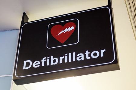 Airport defibrillator sign. Automated External Defibrillators (AED) are portable electronic medical devices to address medical emergencies where a person is experiencing a cardiac problem such as a heart attack.
