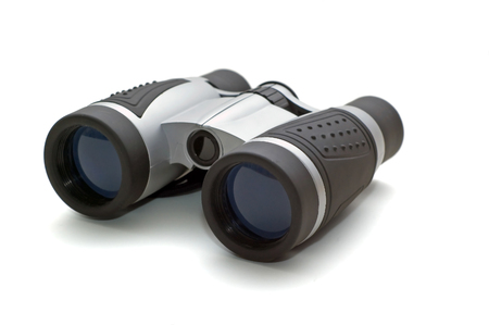Binoculars picture isolated on a white background. Binoculars are modern black and silver made of plastic. Reklamní fotografie
