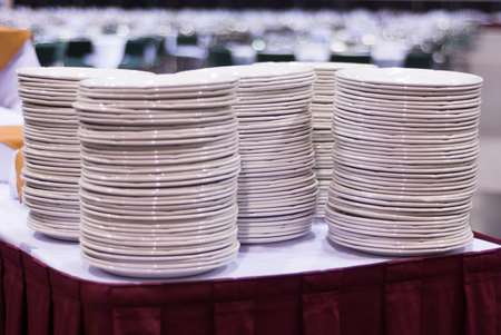 Plates Stacked on an Event Table