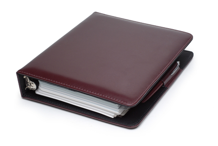 dayplanner: Picture of brown day planner on a white background