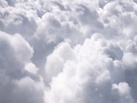 Photo of puffy clouds taken from above the clouds. Usable as a background or for a cloud computing concept.