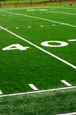 Picture of football field 40 yard line number marker in vertical high resolution with copy space for adding text. Stock Photo
