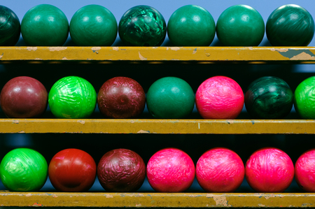 Picture of bowling balls in a ball rack Reklamní fotografie - 77879115