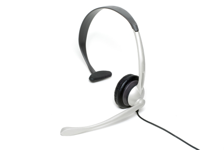 earpiece: Picture of business headphones isolated on a white background