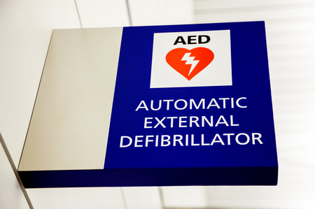 AED Automatic External Defibrillator Sign on a wall at an airport.