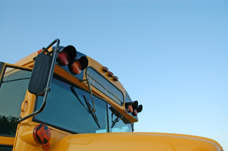 buss: School Bus picture of the right front side with copy space for adding text