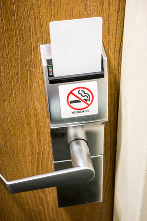 No smoking sign on a hotel room electronic door lock with a key card