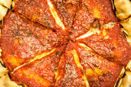Deep dish pizza photo taken from above. Copyright � Paul Velgos with All Rights Reserved.