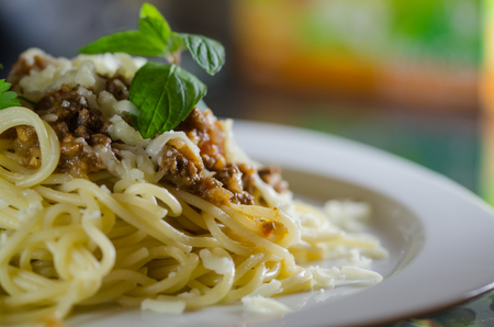 Made with bolognese sauce, mint leaves, cheese shredded spaghetti Stock Photo