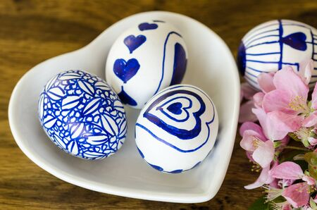 Handmade easter eggs on the wooden table.I painted Easter eggs myself,