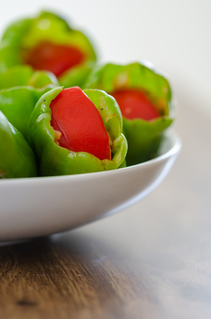 Stuffed peppers in pot ready for cooking.