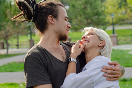 Beautiful loving couple is spending time together in the park.the young man took his love in his arms. Stok Fotoğraf