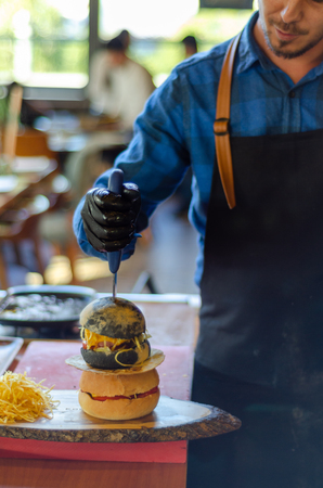 Ready to serve hamburger ,fast food.It is on the wooden table.Blurred background. Stockfoto