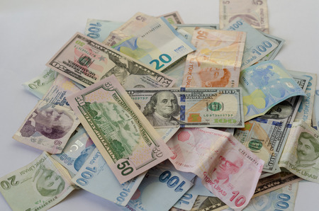 Dollar,liras  and euro banknotes are  on the table.