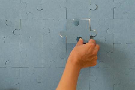 Last connecting piece jigsaw puzzle. Business connection, success and strategy concept, copy space 版權商用圖片