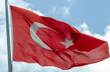 Turkish flag is waving in blue sky Stock Photo