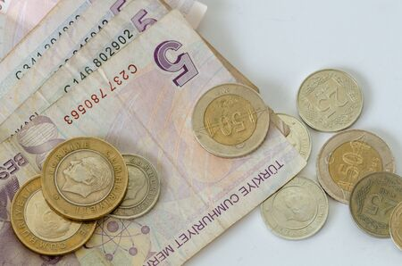 Turkish banknotes and coins are on white background. Stock Photo